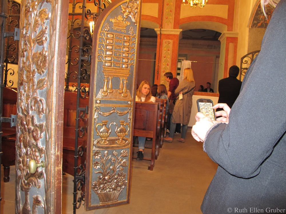 A visitor takes a picture in the 16th-century Remuh synagogue, Krakow