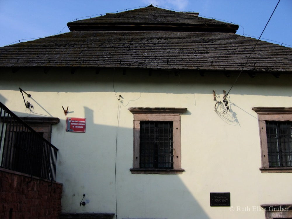 Close up of former synagogue in Checiny, Poland