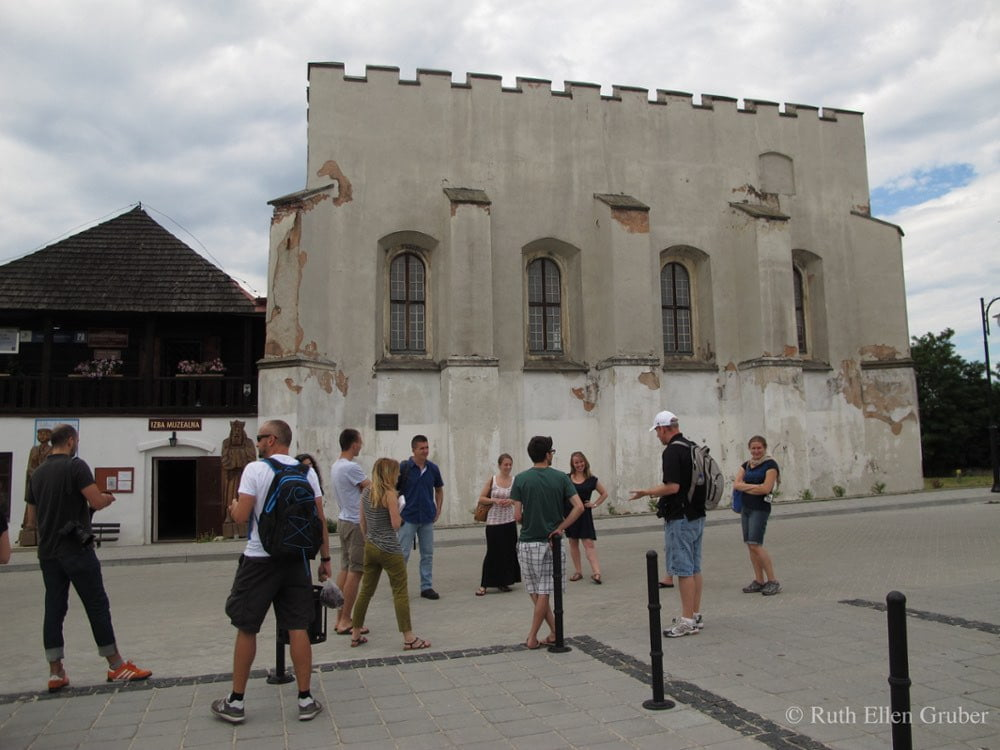 Visitors at the synagogue in Szydlow, Poland