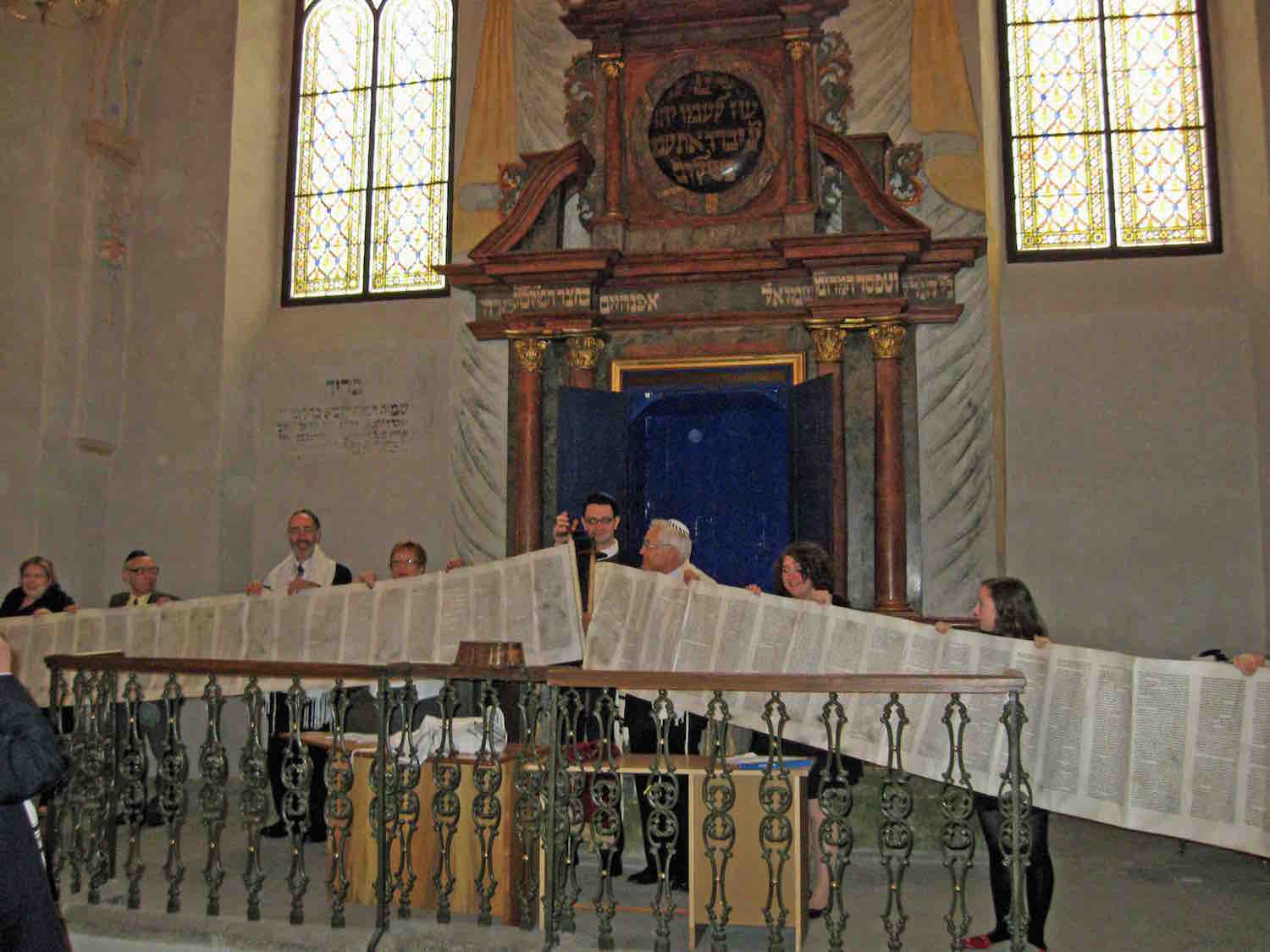 Simchat Torah in Kolín, a Torah scroll displayed in front of the Ark in the baroque synagogue. Photo courtesy of Rabbi Andrew Goldstein